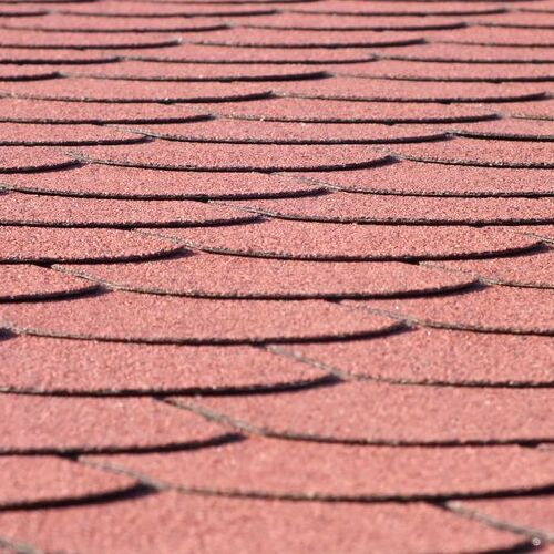 roof replacement with red shingles