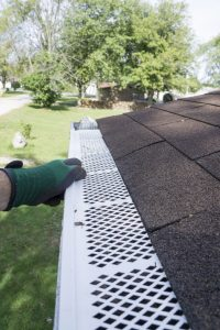 A Contractor Checking His Gutter Guard Installation is Done Correctly