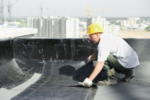 Man Laying Down Roofing