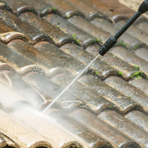 Close Up of Roof Cleaning With High Pressure Water Cleaner