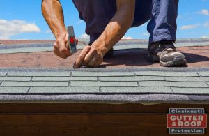 Roofer Hammering Shingles