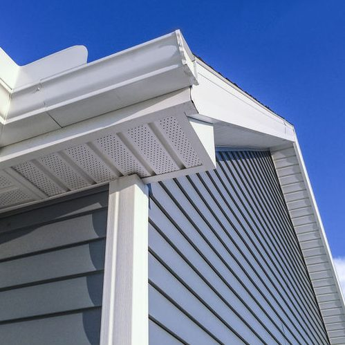 Close Up of Siding of a Home Against Blue Sky