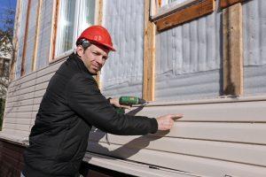 Man Repairing Siding