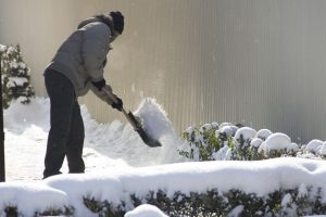 Man Cleaning Up Snow