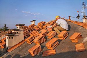 Man Installing Tile Roofing